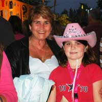 A little girl in a cowboy hat, and her mother
