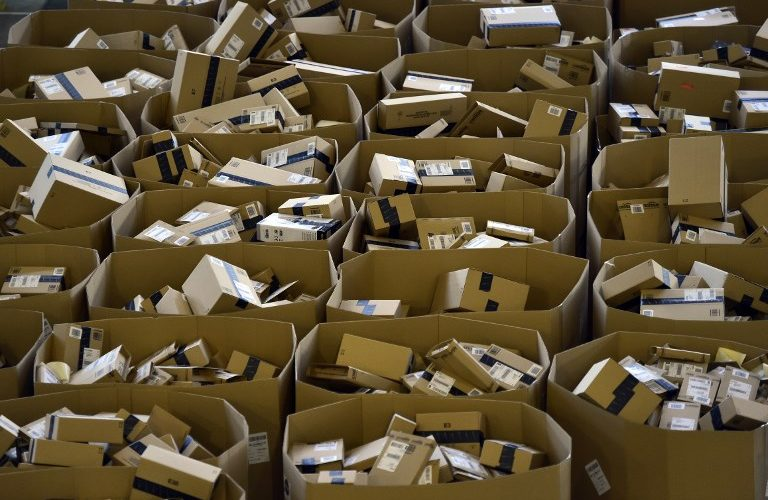 "Packages are stored at the Amazon electronic commerce company's logistics center in San Fernando de Henares, near Madrid, on the eve of ""Black Friday"", on November 24, 2016. / AFP PHOTO / GERARD JULIEN"