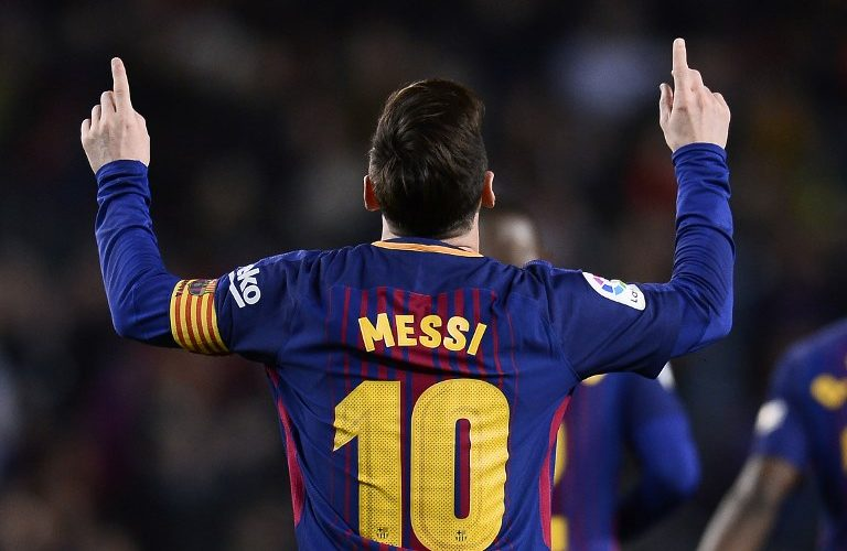 Barcelona's Argentinian forward Lionel Messi celebrates after scoring a goal during the Spanish league football match between Barcelona and Leganes at the Camp Nou stadium in Barcelona on April 7, 2018. / AFP PHOTO / Josep LAGO