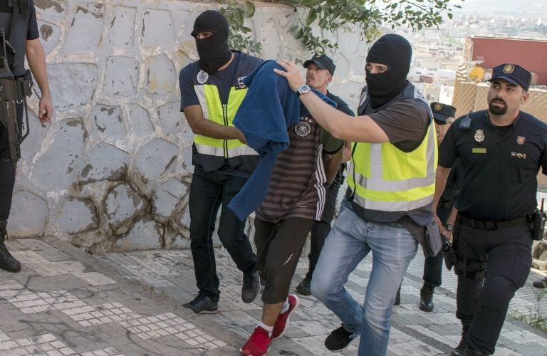 "Police officers arrest a person during and anti-jihad operation in the Spanish enclave of Melilla, on September 6, 2017. Police in Spain and Morocco have arrested six members of a suspected terror cell who were preparing ""large-scale attacks"", officials in both countries said today. The two forces have ""dismantled a jihadist terror cell made up of six individuals, one of whom was arrested in Melilla and five in Morocco,"" said a statement from Spain's interior ministry. Melilla is a tiny Spanish enclave in North Africa.   / AFP PHOTO / BLASCO DE AVELLANEDA"