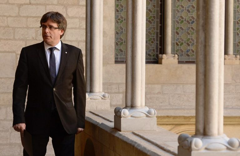 Catalan regional president Carles Puigdemont arrives to give a speech in Barcelona on September 20, 2017. Spanish police detained 13 Catalan government officials as they continued to crack down on preparations for an independence referendum in the region which Madrid says is illegal, sparking angry protests in Barcelona. The operation comes amid mounting tensions as Catalan leaders press ahead with preparations for an independence referendum on October 1 despite Madrid's ban and a court ruling deeming it unconstitutional.   / AFP PHOTO / Josep LAGO