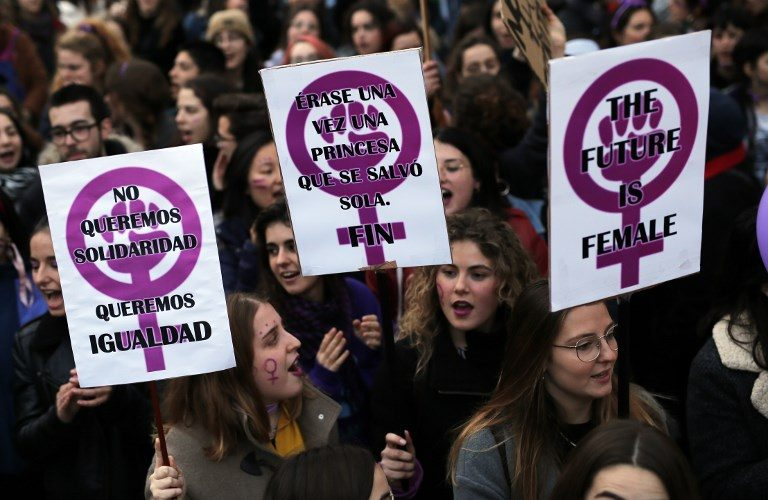 Demonstrators hold placards and shout slogans during a demonstration to defend women's rights on International Women's Day in Barcelona, on March 8, 2018. Spain celebrated International Women's Day today with an unprecedented general strike in defence of their rights that saw hundreds of trains cancelled and countless protests scheduled throughout the day.   / AFP PHOTO / Pau Barrena