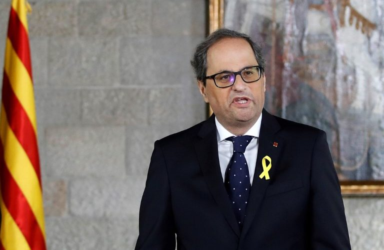 "Newly appointed Catalan president Quim Torra delivers a speech during an official swearing-in ceremony at the Generalitat Palace in Barcelona on May 17, 2018. Torra, Catalonia's controversial new separatist president, was sworn in during a short ceremony where he avoided promising to obey the constitution and pledged instead to be faithful to ""the will of the Catalan people"". / AFP PHOTO / POOL / Alberto Estévez"