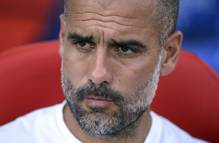 Manchester City's Spanish coach Pep Guardiola looks on before the annual 41st Costa Brava Trophy friendly football match betwen Girona FC vs Manchester City at the Montilivi stadium in Girona on August 15, 2017.  / AFP PHOTO / Josep LAGO