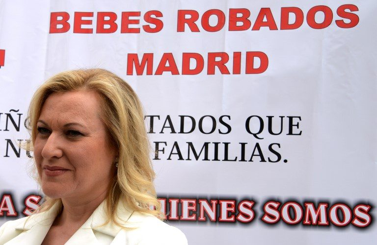 "President of the Bebes Robados Region de Murcia (Stolen Babies Autonomous Region of Murcia) Ines Madrigal poses in front of a banner reading ""Stolen babies Madrid) during a demonstration against Spain's ""stolen babies"" scandal of the Franco era in Madrid on June 18, 2013. More than four decades after her newborn was snatched away, a woman has found her son after DNA tests proved on June 8, 2013 they are related, a rare happy ending in Spain's ""stolen babies"" scandal dating back to the Franco era. Under the dictatorship of General Francisco Franco, the newborns of some left-wing opponents of the regime or unmarried couples were removed from their mothers and adopted.   AFP PHOTO/ DOMINIQUE FAGET / AFP PHOTO / DOMINIQUE FAGET"
