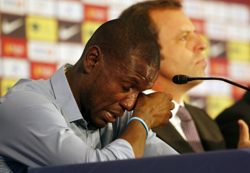 Barcelona's French defender Eric Abidal cries during a press conference in Barcelona on May 30, 2013. Abidal announced today he was leaving the club at the end of the season.   AFP PHOTO/ QUIQUE GARCIA / AFP PHOTO / QUIQUE GARCIA