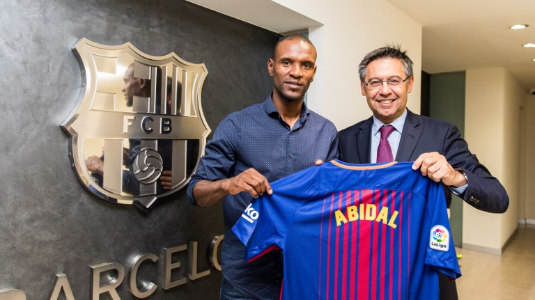 "Former FC Barcelona's French defender Eric Abidal (L) holds a football jersey as he poses with Barcelona's president Josep Maria Bartomeu during his presentation as FC Barcelona's ambassador at the Camp Nou stadium in Barcelona on June 14, 2017. / AFP PHOTO / FC BARCELONA / German PARGA / RESTRICTED TO EDITORIAL USE - MANDATORY CREDIT ""AFP PHOTO/ FC BARCELONA/ GERMAN PARGA"" - NO MARKETING - NO ADVERTISING CAMPAIGNS - DISTRIBUTED AS A SERVICE TO CLIENTS"