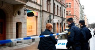 Police officers stand in front of the Couleur gallery where exhibited Salvador Dali sculptures have been stolen by, according to the Police, at least two thieves who smashed the entrance window setting the alarm off at 4 a.m. on January 30, 2020, in Stockholm, Sweden. (Photo by ALI LORESTANI / TT News Agency / AFP) / Sweden OUT (Photo by ALI LORESTANI/TT News Agency/AFP via Getty Images)