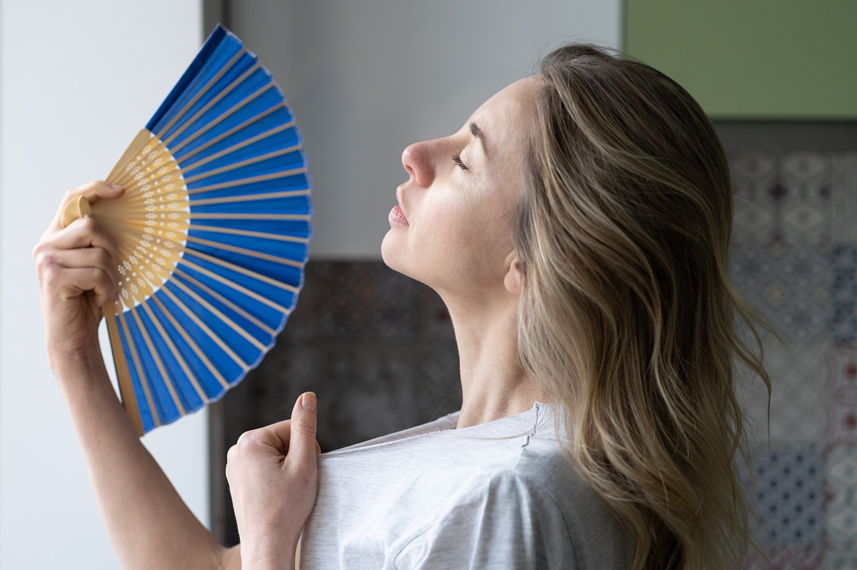 Overheated Woman In T Shirt Using Wave Fan Suffer From Heat Sweating, Cools Herself, Feels Sluggish